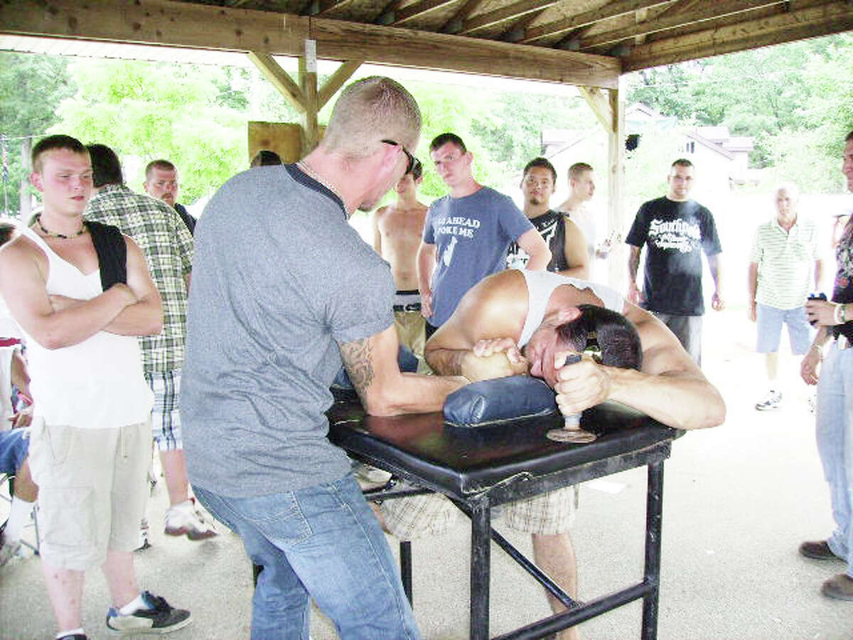 Friendly competition: Two men duke it out in an arm wrestling contest at the Bitely Homecoming Celebration 2011. (File photo)