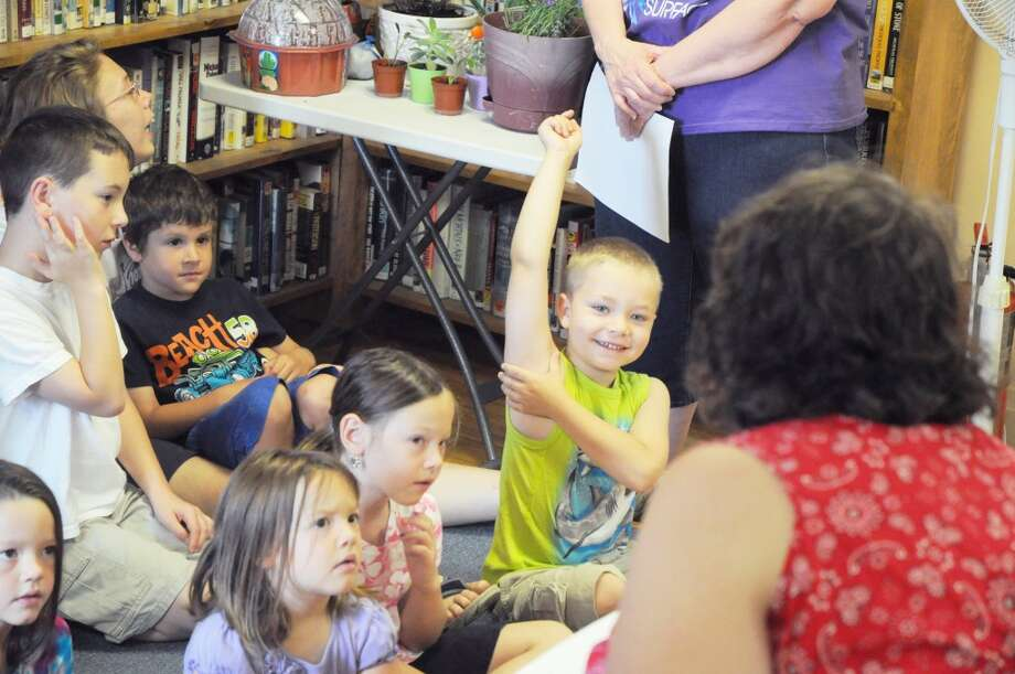 Library activities: Children enjoy one of many activities during Chase Library's summer reading program. (File Photo)