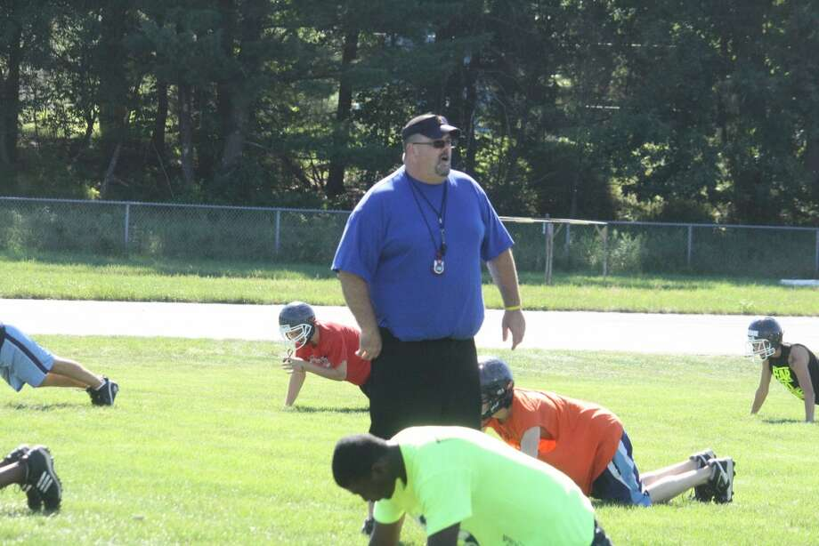CONDITIONING: Football coach Doug Bolles of Baldwin, pictured here at a 2012 preseason practice, is supervising weight room activities for his players his summer.(File photo)