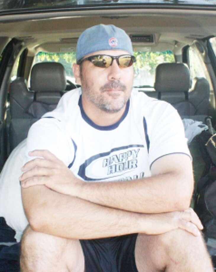 SOFTBALL: Jamie Batka of Grand Haven takes a break from Troutarama softball action. (Star photo/John Raffel)