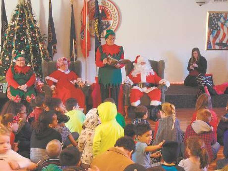 "Santa's elf, Betty Dermyer, read ""The Night Before Christmas"" to the children attending the Christmas party at AMVETS Post No. 1988."