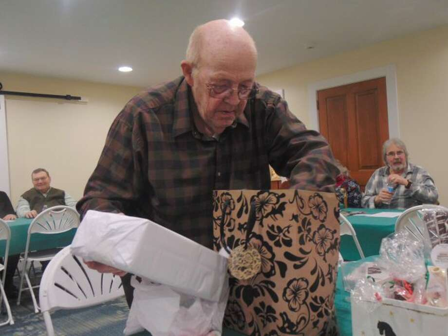 Ron Dionne received a candle set. (Star photo/Shanna Avery)