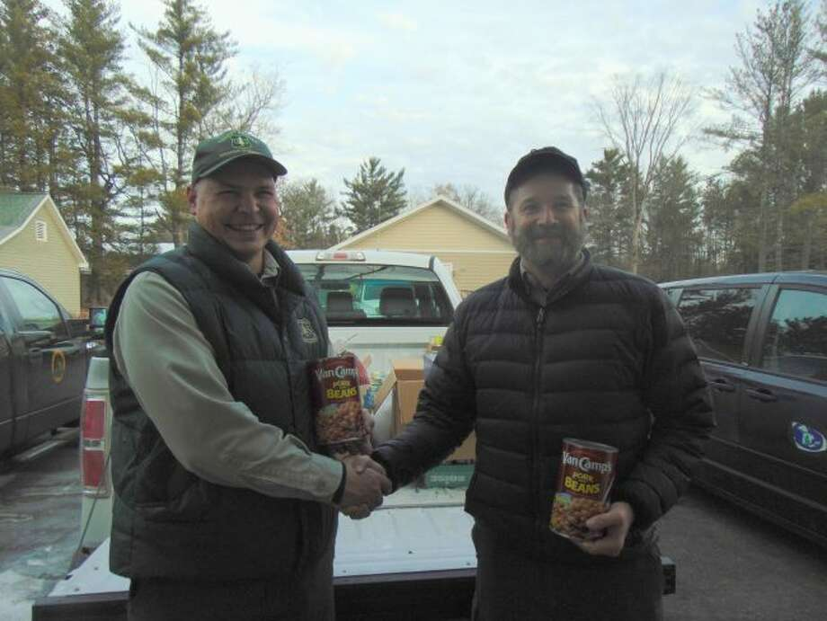 District Forest Ranger Jake Lubera, left, and Jim Gallie, park manager for the DNR Ludington office, right, were happy with local participation. (Star photo/Shanna Avery)