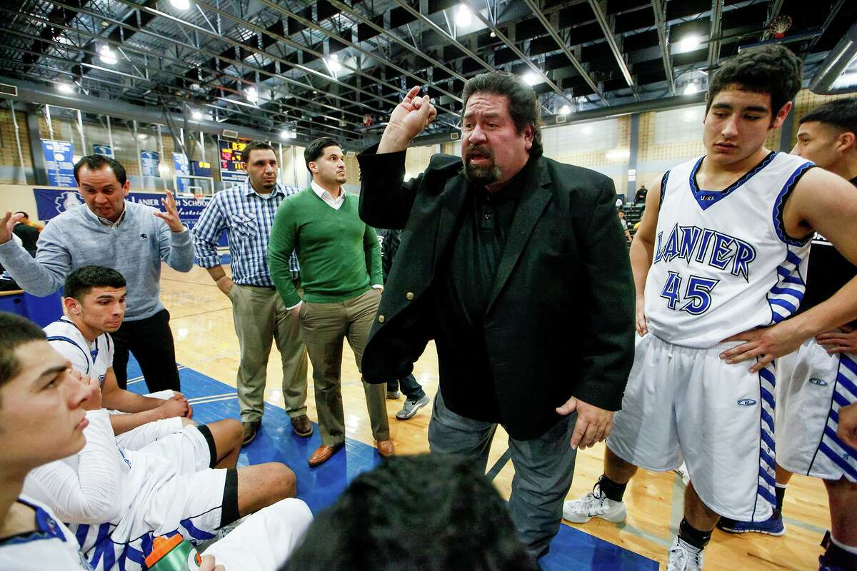 Rudy Bernal, center, won 567 basketball games and four district titles in 31 years with Lanier.
