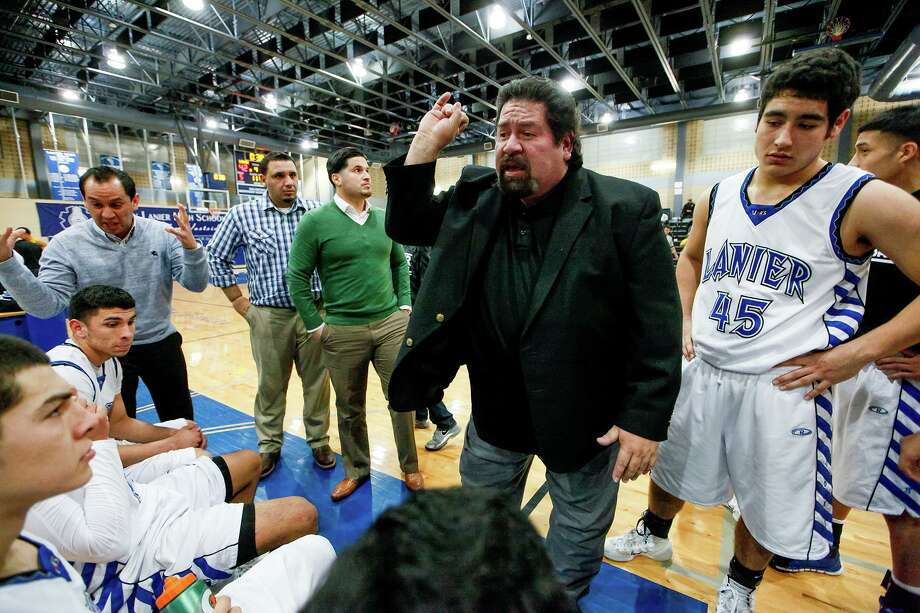 Rudy Bernal, center, won 567 basketball games and four district titles in 31 years with Lanier. Photo: Marvin Pfeiffer / Staff Photographer / Express-News 2013