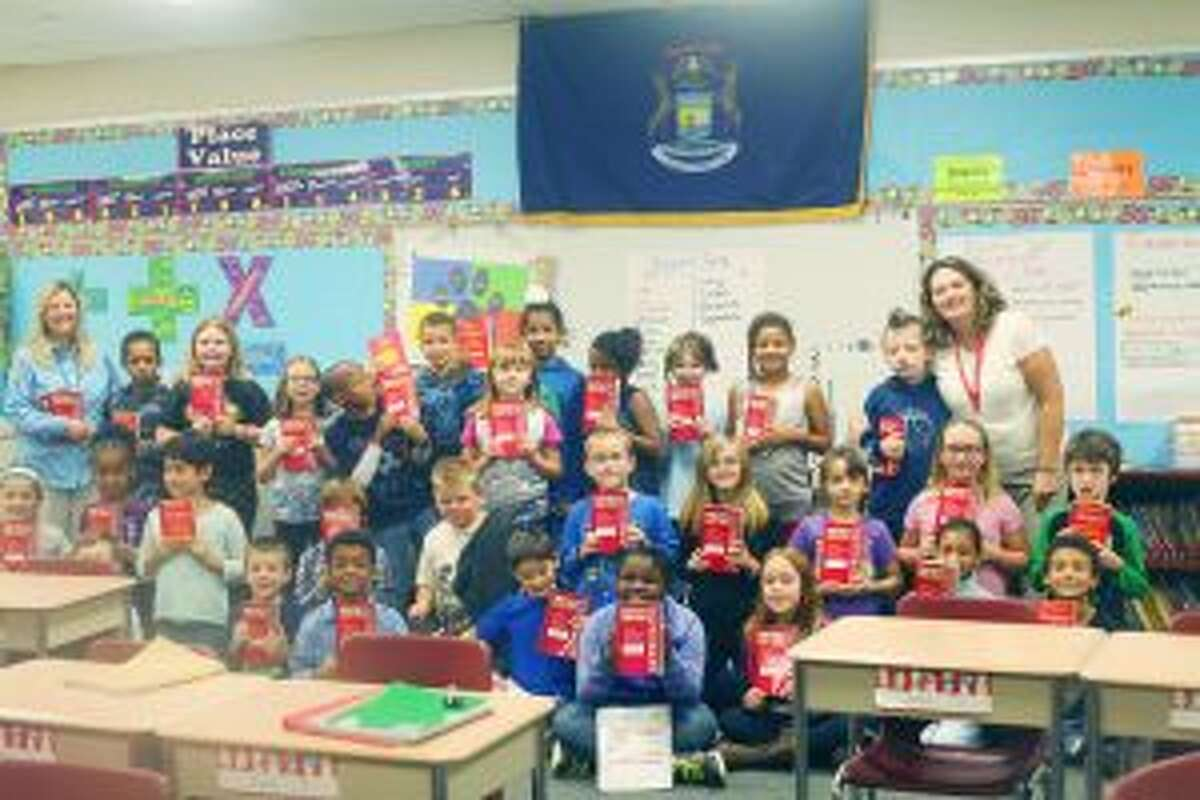 DICTIONARIES: Students from Melissa Johnson's third-grade class were among many third-graders at Baldwin Community Schools who received dictionaries from the Baldwin Lions Club.