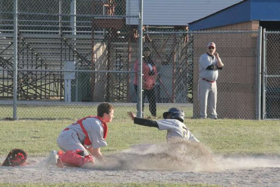DeMarko Williams slides safely into home plate.