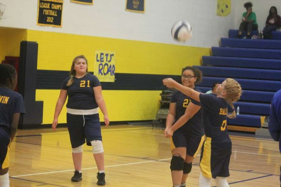 Baldwin junior high volleyballers work on their game.