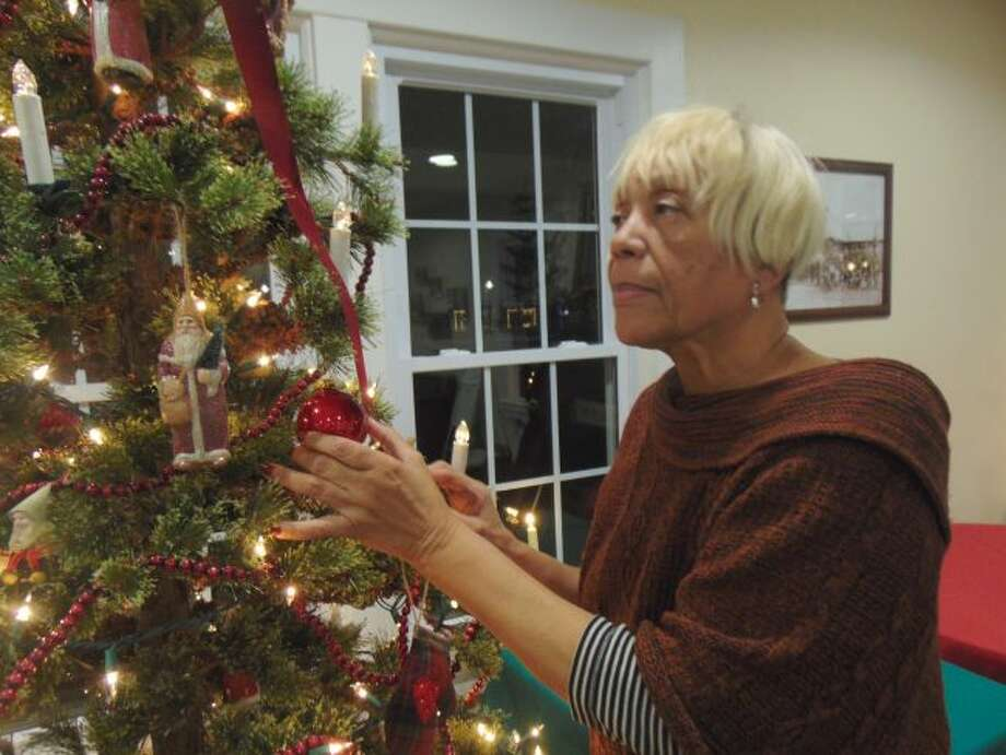 Sandy Clarke smiles at the nostalgia the holiday season brings each year of childhood in Henry County, Tennessee. (Star photos/Shanna Avery)