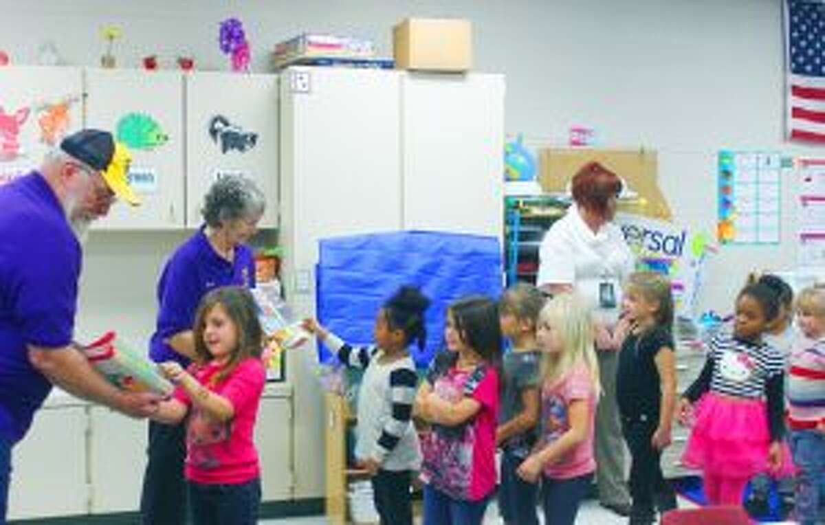 LIONS CLUB: The Baldwin Lions Club handed out books to kindergartners at Baldwin Elementary School.