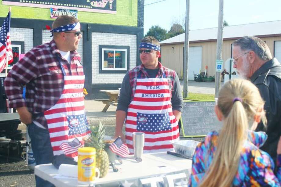 """WINNERS: Travis Kuipers and Josh Williams won both the chili contest and best use for theme """"Pure Luther"""" with their Team America chili. (Lake County Star photo/Shanna Avery) Use which one you think best!"""