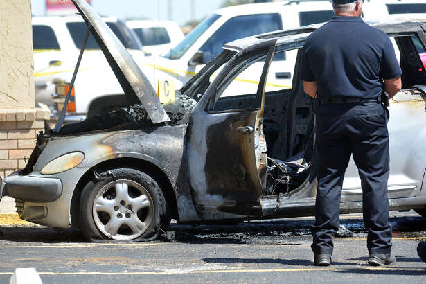 Law enforcement officials surround a vehicle that caught on fire Friday afternoon killing a 3-year-old child.