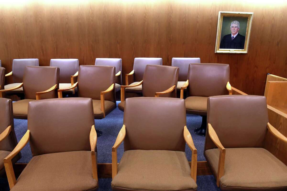 Empty seats in the jury box of Courtroom 6A at Superior Court in New Haven.