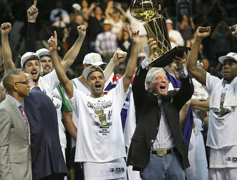 San Antonio Spurs' Marco Belinelli, Tony Parker, Peter Holt, Kawhi Leonard and others celebrate after defeating the Miami Heat in Game 5 of the 2014 NBA Finals Sunday June 15, 2014 at the AT&T Center. The Spurs won 104-87. Photo: Edward A. Ornelas, San Antonio Express-News