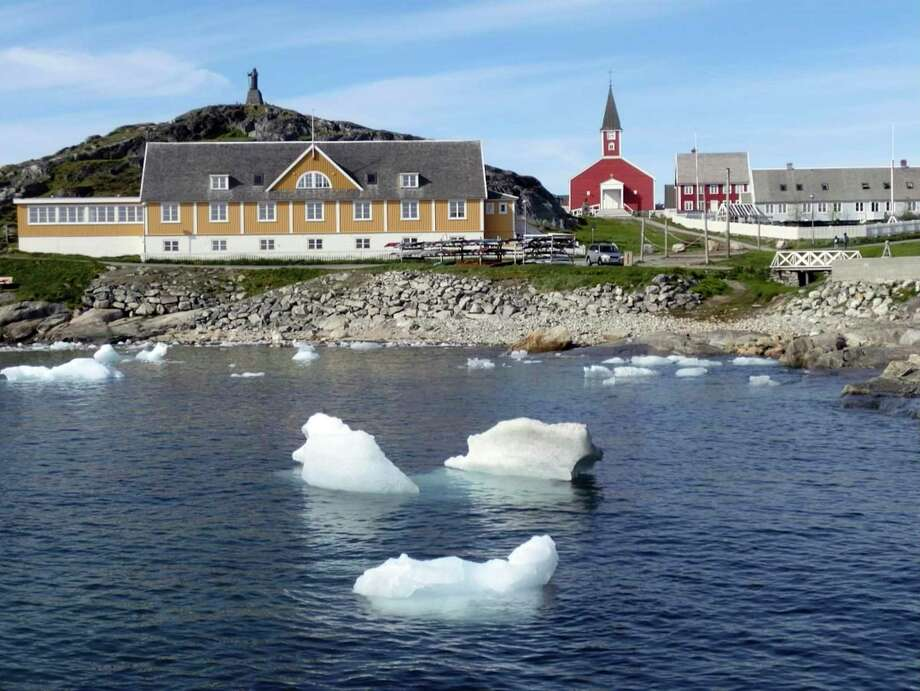 Small pieces of ice float off Greenland this summer as the island's glaciers melt at a record rate. The National Oceanic and Atmospheric Administration reported Thursday that July 2019 was the hottest month on planet Earth since record-keeping began in the 1880s. On July 25, thermometers in Cambridge, England, soared to 101.7 degrees — an all-time record for the United Kingdom. That same day, Paris saw a high of 108.7, which broke the previous all-time record by a four degrees. Photo: Keith Virgo /Associated Press / Keith Virgo