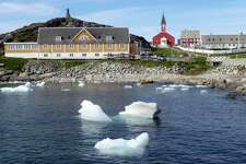 Small pieces of ice float off Greenland this summer as the island's glaciers melt at a record rate. The National Oceanic and Atmospheric Administration reported Thursday that July 2019 was the hottest month on planet Earth since record-keeping began in the 1880s. On July 25, thermometers in Cambridge, England, soared to 101.7 degrees - an all-time record for the United Kingdom. That same day, Paris saw a high of 108.7, which broke the previous all-time record by a four degrees.