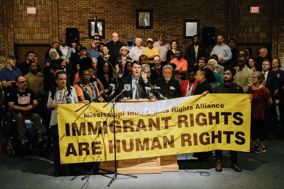 Activists and advocates at a news conference organized by the Mississippi Immigrants Rights Alliance at a masonic lodge in Jackson  on Aug. 8, a day after many migrant parents were rounded up by federal authorities. Photo: William Widmer /New York Times / NYTNS