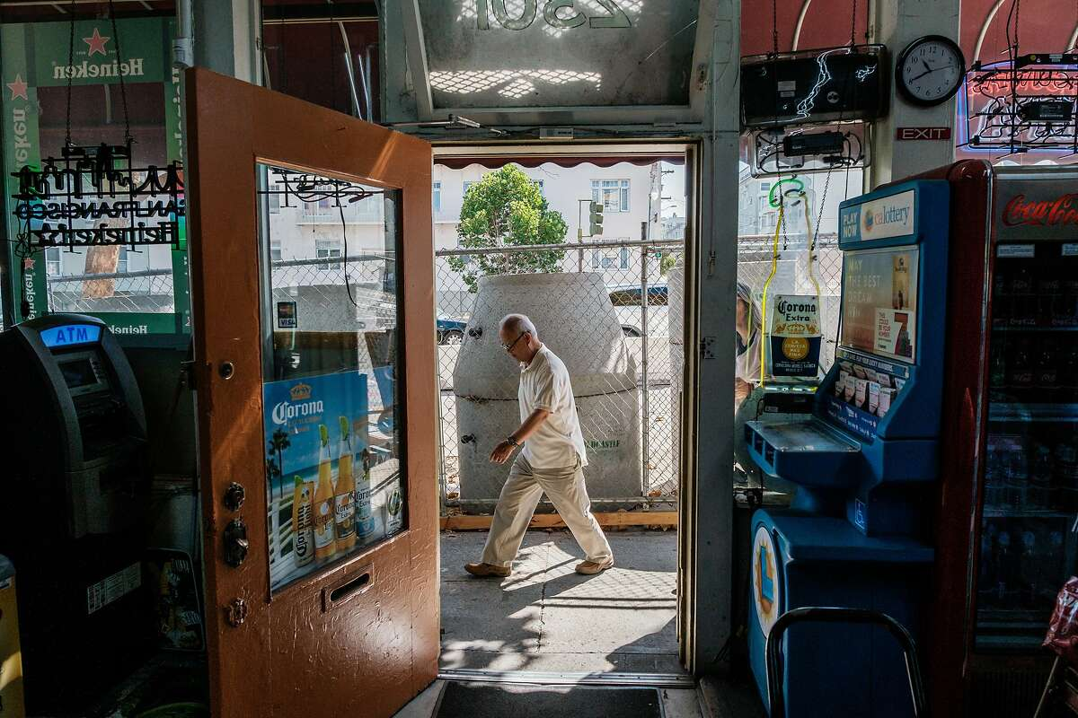 August 16, 2019 - A view form inside Van Ness and Vallejo Market as owner John Lee walks past the construction in front of his shop. Muni says it's learned some lessons in the first phase of the Van Ness Ave project, and it's taking a new approach to construction that should speed things up and finish the street work by 2021. Merchants and residents have their doubts.