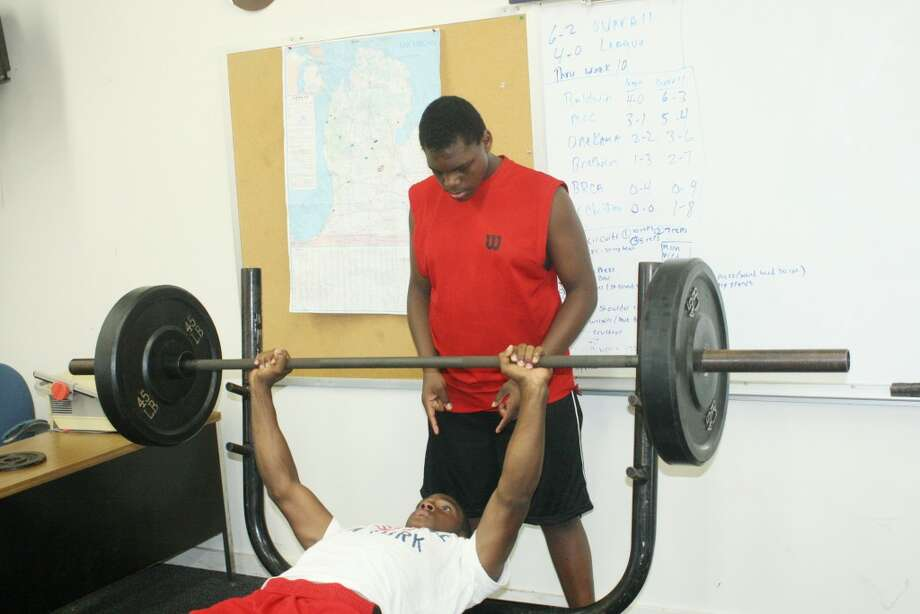 LIFTING: Dashawn Moore works out in the Baldwin weight room while La'Kie Donald watches. (Star photo/John Raffel)