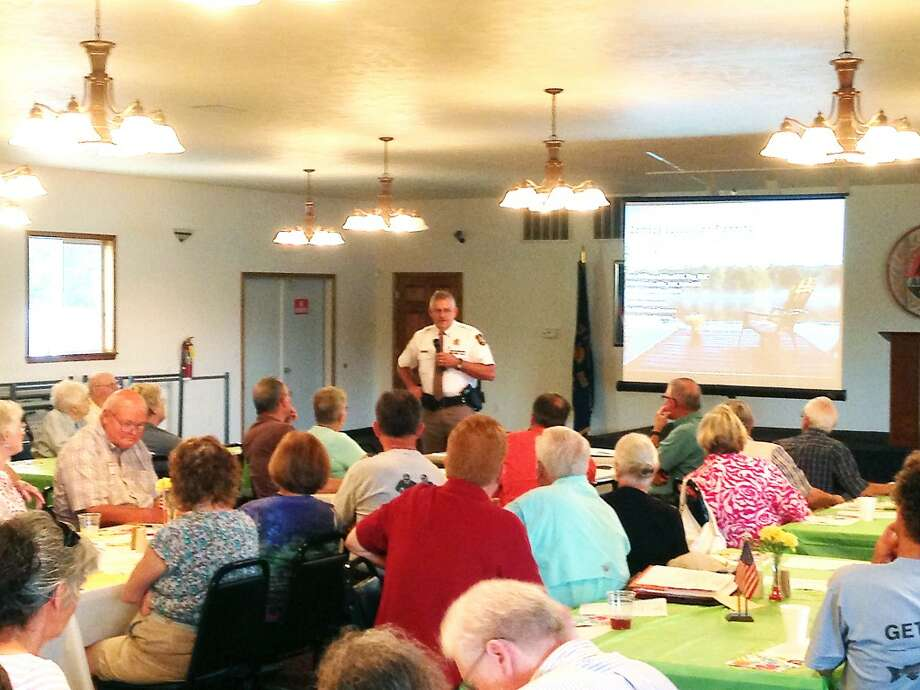 COMING TOGETHER: Lake County Undersheriff Dennis Robinson spoke to more than 70 members of the Lake County Riverside Property Owners Association on Saturday about the county's 911 system and seasonal ownership. Author David Fry also spoke at the association's annual luncheon. (Courtesy photo)