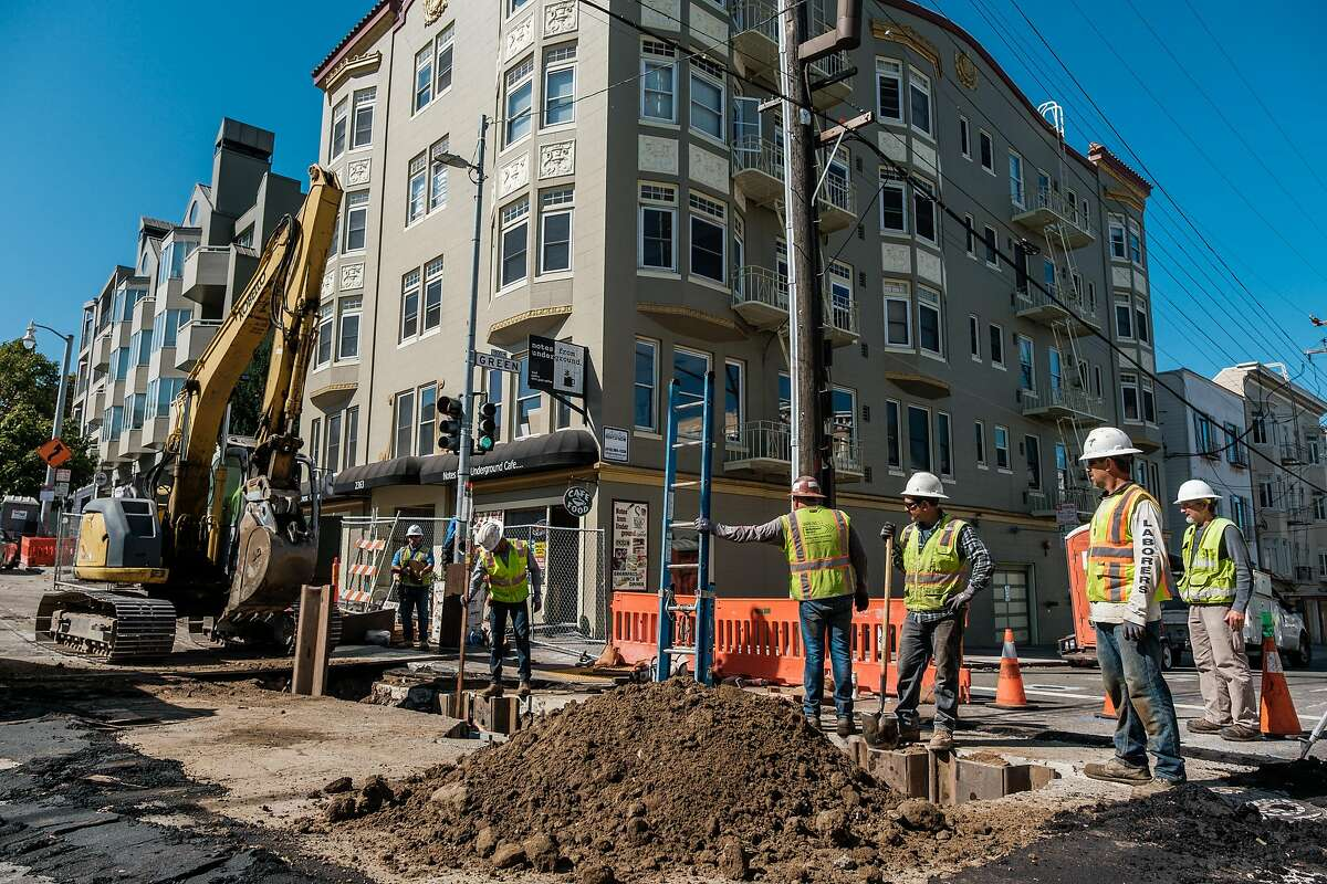 August 16, 2019 - Construction crews can be seen working on the corner of Van Ness and Green. Muni says it's learned some lessons in the first phase of the Van Ness Ave project, and it's taking a new approach to construction that should speed things up and finish the street work by 2021. Merchants and residents have their doubts.