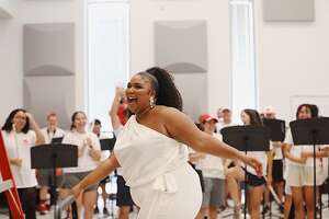 Lizzo visited with the University of Houston Spirit of Houston band.