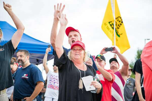 """MANCHESTER, NH - AUGUST 15: Trump supporters chant """"four more years!"""" in front of anti-Trump protesters outside of a MAGA Campaign rally on August 15, 2019 in Manchester, New Hampshire. (Photo by Scott Eisen/Getty Images)"""