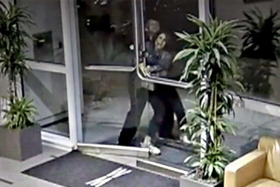A screen shot from security video shows Austin James Vincent, 25, grabbing Paneez Kosarian and preventing her from entering her Embarcadero condo on Aug. 11, 2019. San Francisco police say he assaulted her. Photo: Watermark Building Security Footage