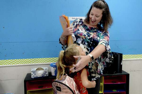 "Third grade teacher Tara Johnson gets a hug and warm visit from Kaylee Baters, whose sister was a student of Johnson's last year, during a ""meet the teacher"" day for parents and students at Vidor Elementary School Friday. Classes resume for Vidor ISD students Monday. Photo taken Friday, August 16, 2019 Kim Brent/The Enterprise"