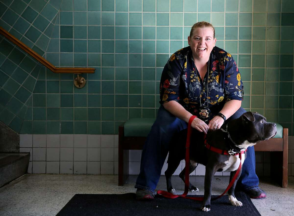 Eleanor Sadler, a sergeant with the San Francisco Animal Care and Control, poses for a portrait with Smokey Bear, a pitbull, in San Francisco, Calif., on Thursday, August 15, 2019.