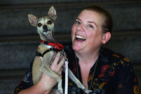 Eleanor Sadler, a lieutenant with San Francisco Animal Care and Control, with Twinkle Holiday, an adoptable Italian greyhound at the S.F. facility. Photo: Yalonda M. James / The Chronicle