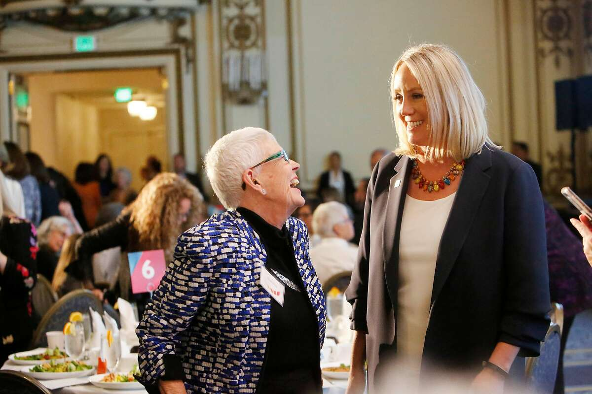 Stephanie Schriock (right), Emily's List president, talks with Susan F. Rice (left) during the Emily's List annual luncheon fundraiser at the Fairmont Hotel on Friday, August 16, 2019 in San Francisco, CA.