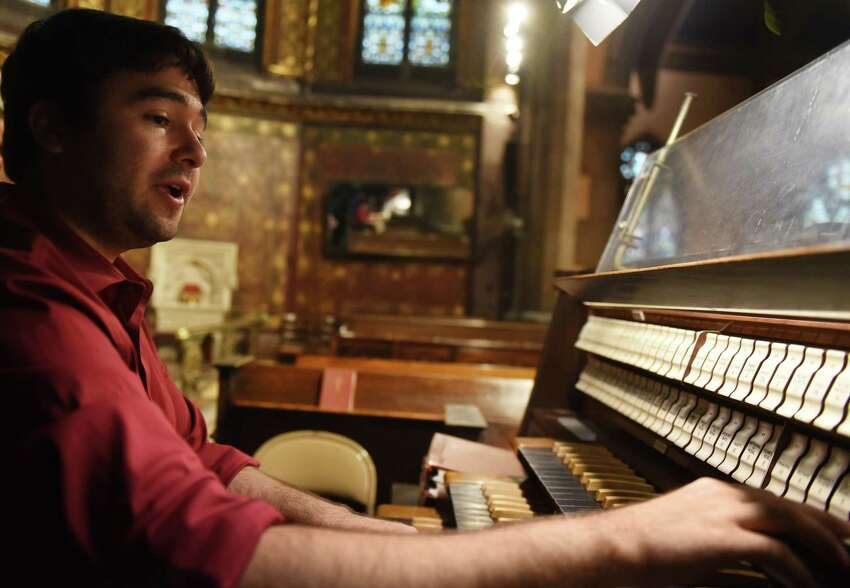 Aspiring concert organist Jacob Kruzansky practices his budding talents on the pipe organ at St. Peter's Episcopal Church on Tuesday, Aug. 13, 2019, in Albany, N.Y. (Will Waldron/Times Union)