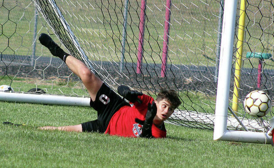 Alton goalie Owen Macias keeps on eye on the ball he just deflected wide during a preseason practice scrimmage at North Middle School in Godfrey. Macias and the redbirds will open their season Aug. 30 against Breese Central in the Kahok/Redbird Classic at Collinsville High School. Photo: Pete Hayes | The Telegraph