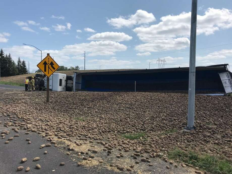 On Friday Aug. 16 around 2 p.m. in Hillsboro, a city near Portland, Oregon, a semi-truck overturned, scattering potatoes across Highway 26. Photo: Courtesy Of Hillsboro Police Department
