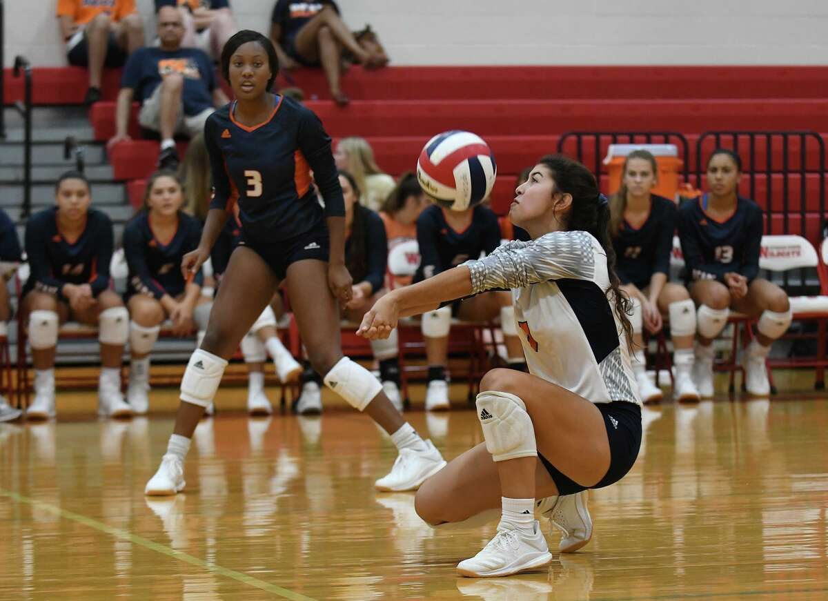 Bridgeland senior libero Makensie Garner makes a pass in front of teammate Alyssa McMorris (3) against Oak Ridge during their third place game of the Gold Bracket at the 2019 Katy/Cy-Fair Volleyball Classic at Cy Woods High School on August 10, 2019.