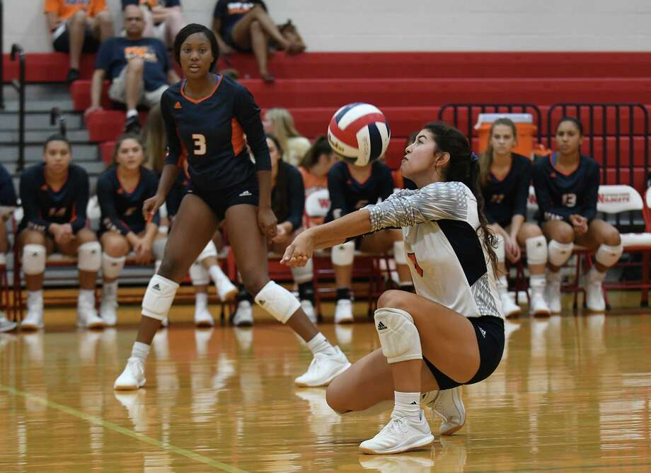 Bridgeland senior libero Makensie Garner makes a pass in front of teammate Alyssa McMorris (3) against Oak Ridge during their third place game of the Gold Bracket at the 2019 Katy/Cy-Fair Volleyball Classic at Cy Woods High School on August 10, 2019. Photo: Jerry Baker, Houston Chronicle / Contributor / Houston Chronicle