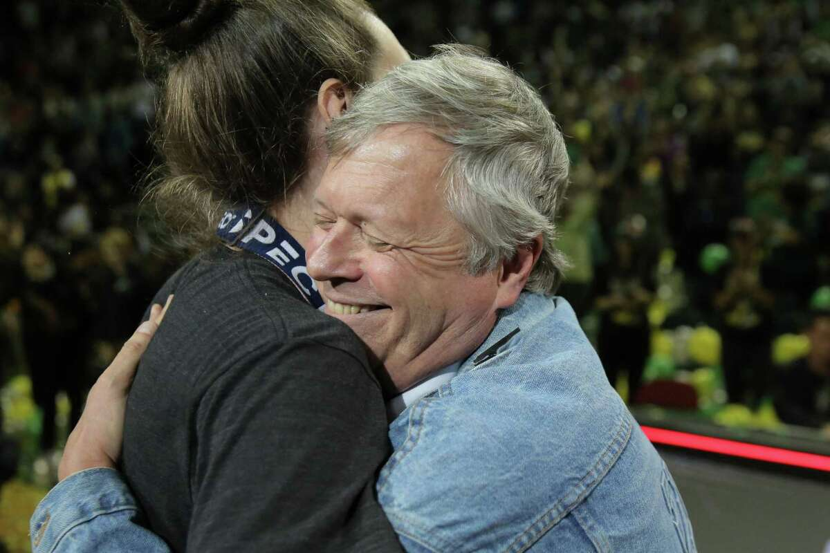 Seattle Storm head coach Dan Hughes hugs Breanna Stewart during a rally at KeyArena to celebrate the Storm winning the WNBA basketball championship in 2018.