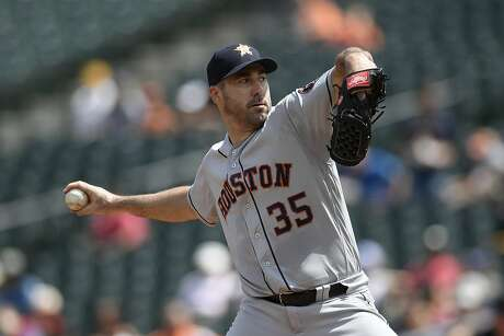 Houston Astros starting pitcher Justin Verlander delivers a pitch during the first inning of a baseball game against the Baltimore Orioles, Sunday, Aug. 11, 2019, in Baltimore. (AP Photo/Nick Wass)
