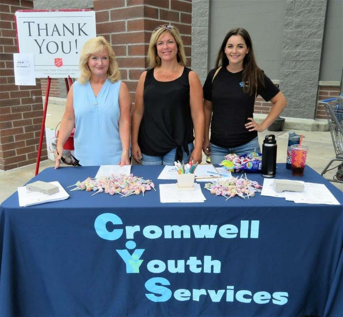 """From left, Marcia Sacco, Youth Services program assistant, Amy Saada, Human Services director, and Katelynn Kelly Puorro, youth serves director. Youth and family services officials are expressing their gratitude to the many residents who stepped forward to """"Stuff-a-Bus"""" with back-to-school items earlier this month."""