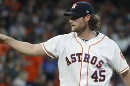 Houston Astros starting pitcher Gerrit Cole (45) asking to clarify a pitch to Colorado Rockies Charlie Blackmon during the third inning of an MLB baseball game at Minute Maid Park, Wednesday, August 7, 2019.