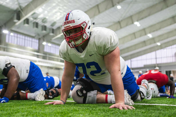 SMU offensive lineman Nick Dennis, a Lee grad, stretches and get ready for football practice. Photo courtesy of SMU athletics