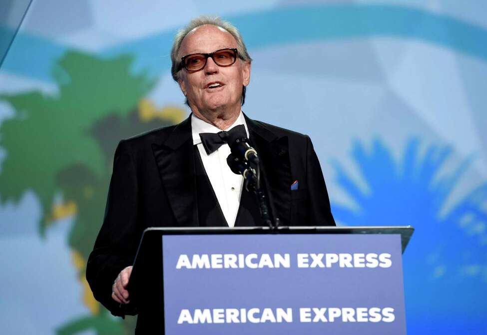 FILE - In this Tuesday, Jan. 2, 2018 file photo, Peter Fonda presents the Desert Palm achievement award at the 29th annual Palm Springs International Film Festival, in Palm Springs, Calif. Fonda, the son of a Hollywood legend who became a movie star in his own right both writing and starring in counterculture classics like a€œEasy Rider,a€ has died. His family says in a statement that Fonda died Friday, Aug. 16, 2019, at his home in Los Angeles. He was 79. (Photo by Chris Pizzello/Invision/AP, File)