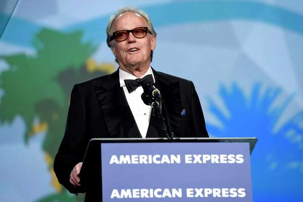 FILE - In this Tuesday, Jan. 2, 2018 file photo, Peter Fonda presents the Desert Palm achievement award at the 29th annual Palm Springs International Film Festival, in Palm Springs, Calif. Fonda, the son of a Hollywood legend who became a movie star in his own right both writing and starring in counterculture classics like a€œEasy Rider,a€ has died. His family says in a statement that Fonda died Friday, Aug. 16, 2019, at his home in Los Angeles. He was 79. (Photo by Chris Pizzello/Invision/AP, File)