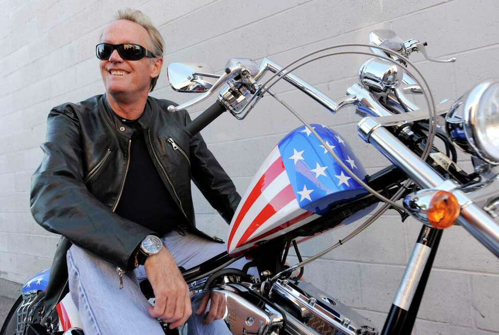 FILE - In this Friday, Oct. 23, 2009 file photo, Peter Fonda, poses atop a Harley-Davidson motorcycle in Glendale, Calif. Fonda, the son of a Hollywood legend who became a movie star in his own right both writing and starring in counterculture classics like a€œEasy Rider,a€ has died. His family says in a statement that Fonda died Friday, Aug. 16, 2019, at his home in Los Angeles. He was 79. (AP Photo/Chris Pizzello, File)