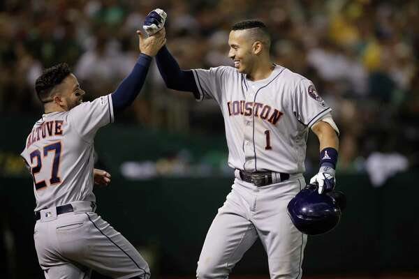 Carlos Correa, right, twice celebrated with Jose Altuve after clubbing homers Thursday, including the 100th of his career.