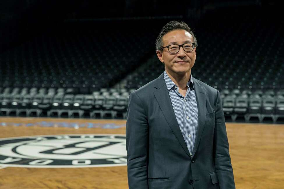 FILE -- Joseph Tsai, a co-founder of Chinese internet retail giant Alibaba and owner of the WNBA's New York Liberty, at the Barclays Center in Brooklyn, May 9, 2019. Tsai, who already owns 49 percent of the New York Nets, is closing in on a record-breaking deal to gain sole ownership of the NBA team. (Hiroko Masuike/The New York Times)