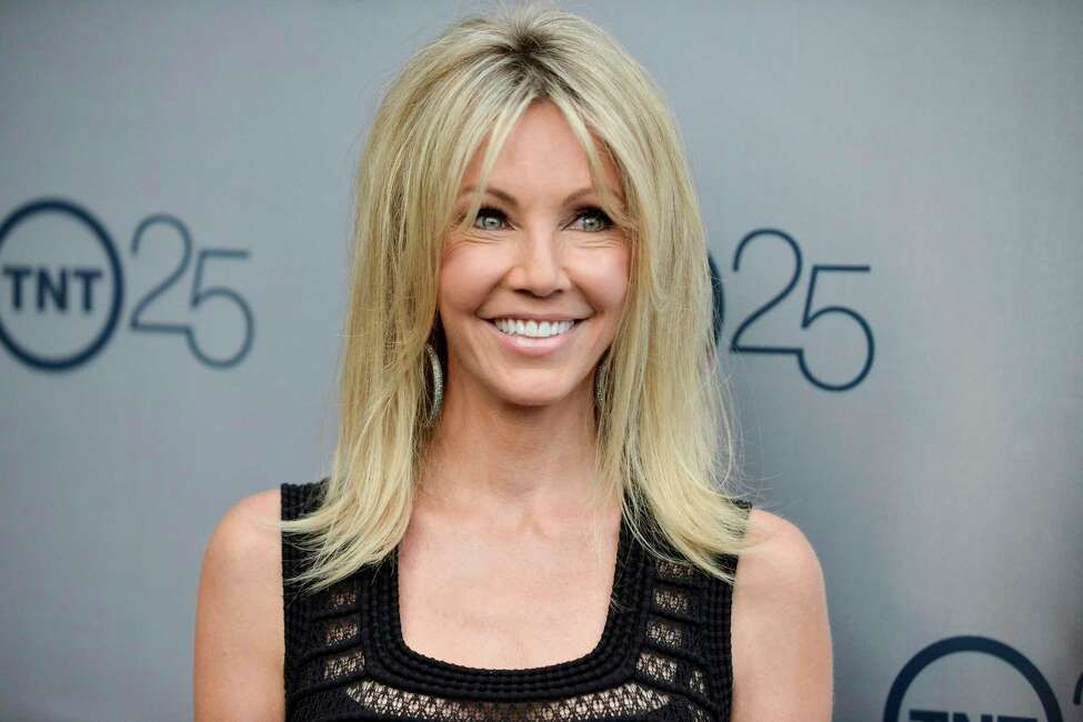 FILE - In a July 24, 2013 file photo, Heather Locklear arrives at the TNT 25th Anniversary Party at The Beverly Hilton Hotel in Los Angeles. Locklear pleaded no contest to charges that she fought with first responders during two visits to her Southern California home last year. Locklear entered the plea in Ventura County court Friday, Aug. 16, 2019, to five counts of battery on a peace officer, one count of battery on emergency personnel and two counts of resisting, obstructing or delaying a peace officer. (Photo by Richard Shotwell/Invision/AP, File)