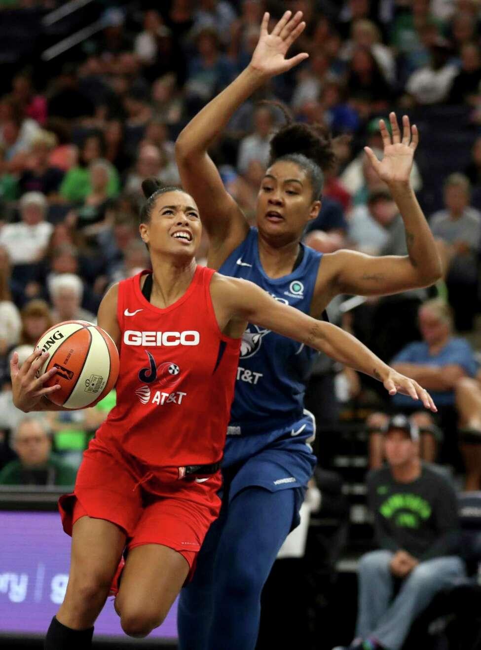 Minnesota Lynx's Damiris Dantas, right, defends against Washington Mystics' Natasha Cloud (9) during the second half of a WNBA basketball game Friday, Aug. 16, 2019, in Minneapolis. (David Joles/Star Tribune via AP)