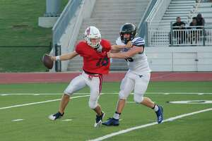 Clear Lake's Donovan Sweeney is pressured by Friendswood's Jackson Stephens Friday at Challenger Columbia Stadium.